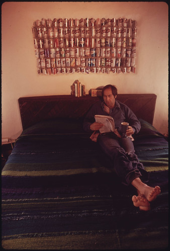 Lawyer Steve Natelson, Who Lives near Taos, New Mexico Relaxes on the Bed of His Experimental Home Built of Empty Steel Beer and Soft Drink Cans. | by The U.S. National Archives