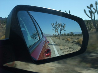 Desert road in car mirror | by akademy