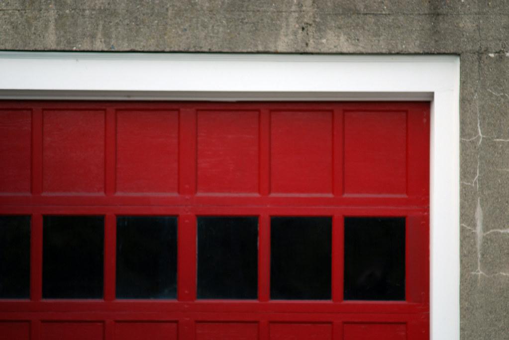 Red garage door below a house on the hill rachel james for Rachel s fairy doors