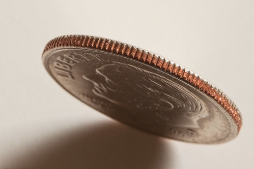 Dime on edge | by GenBug