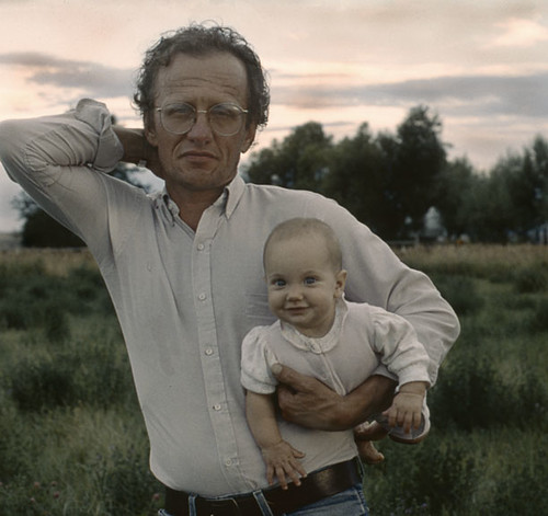 40-50 Year Old Man Holding Infant