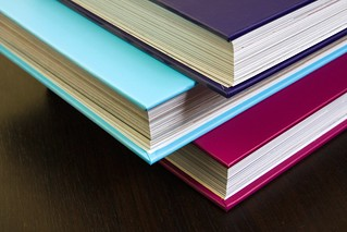 Thick encyclopedias with colorful hardcovers | by Horia Varlan