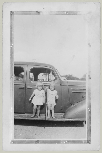 Two children on a running board