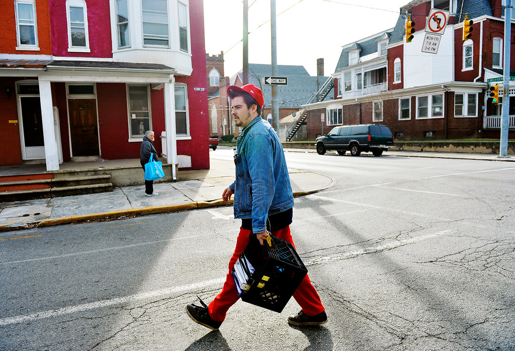 © 2016 by The York Daily Record/Sunday News. Tanner Doyle, 24, crosses West King Street to prepare an Abundant Life Outreach van for his food deliveries, on Friday, Jan. 15, 2016. Doyle, who lives in True North recovery house, operated by the same church that houses Abundant Life, said he relapsed three times since coming to True North in June 2015 but feels confident in his ability to stay clean after a family intervention in November.