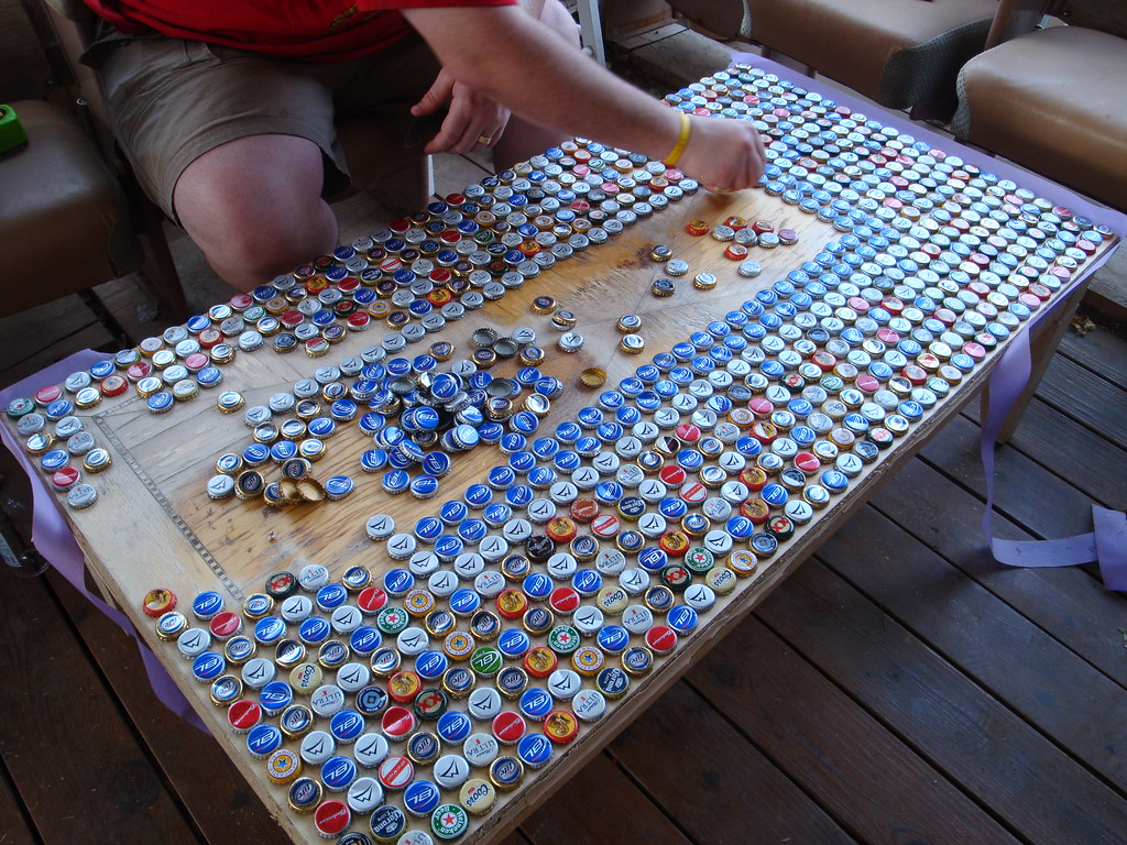 Bottle cap table lots of work amy flickr for What to make with beer bottle caps