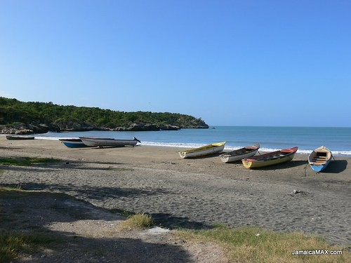 Boats sit on Treasure Beach Jamaica | by alfredmoya