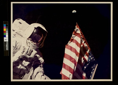 Schmitt with Flag and Earth Above | by George Eastman House