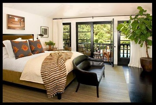 Neutral bedroom black floor lush tree california home for Nickey kehoe