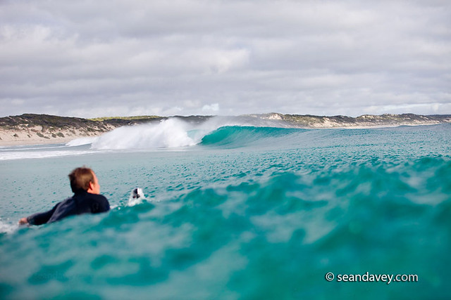 Ryan >> A surfer paddling over a wave on King Island, Tasmania | Flickr