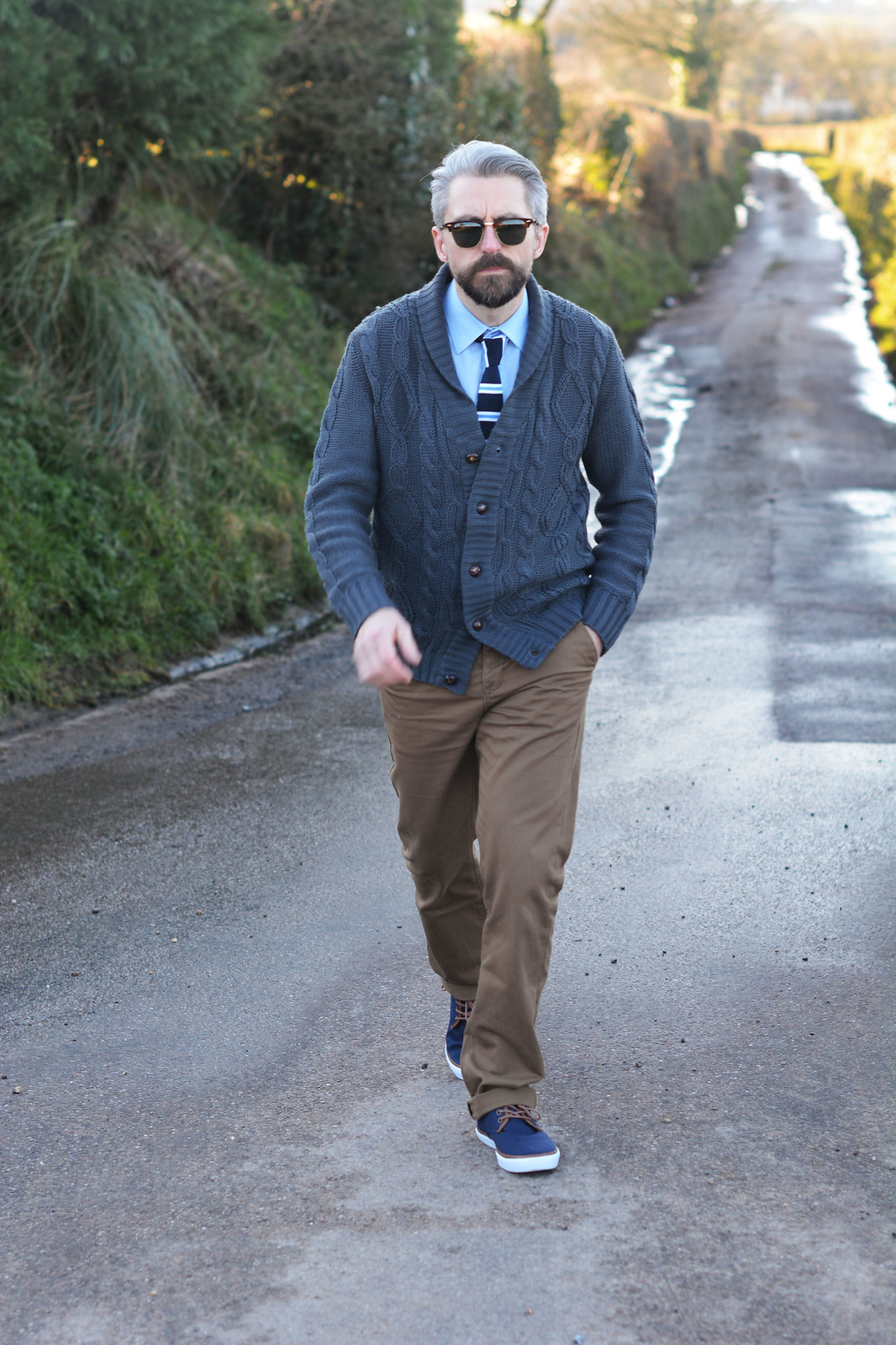 Smart casual menswear: Cable knit cardigan \ shirt and striped tie \ camel chinos \ canvas lace-up shoes \ RayBan Clubmasters | Silver Londoner, over 40 menswear