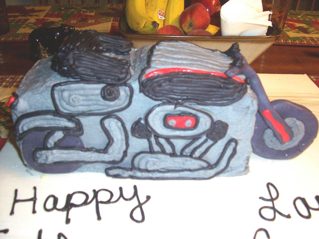 Motorcycle Cake Made with cake and icing, fondant tire ...