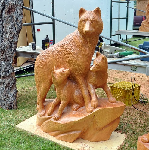 Art in park wolf and pups chainsaw carving that was for