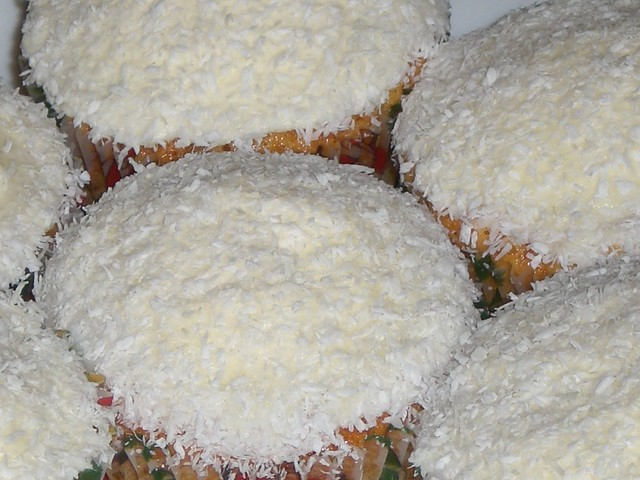snowball cupcakes | Extra fluffy coconut cupcakes topped wit ...