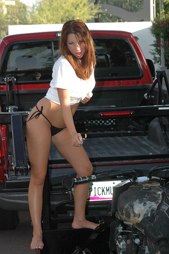 X Tra Lift Truck With A Hottie Torching A Bike She Seems