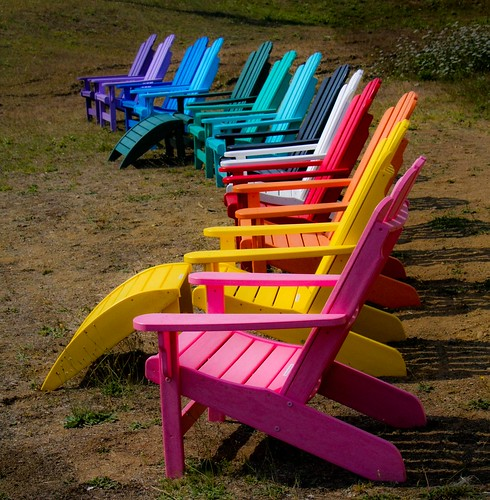 A Sweep Of Colorful Adirondack Chairs For Sale