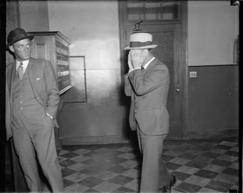 Police suspect hides his face | by Boston Public Library