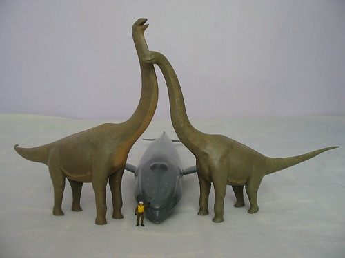 blue whale sandwiched between an argentinosaurus and bra