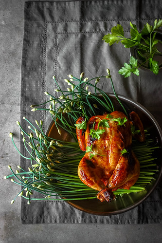 Roast Chicken on a bed of Chive blossoms | by Nusrat Suborna