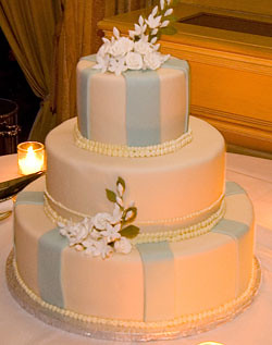 White Wedding Cake With Light Blue Stripes