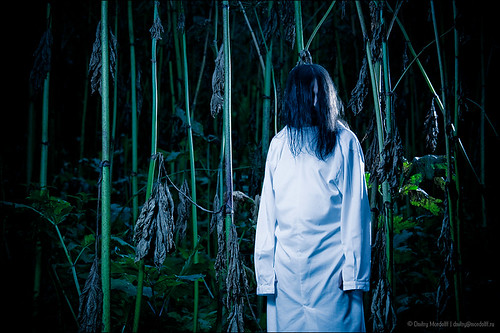strange creature with long hair in dark forest buy at