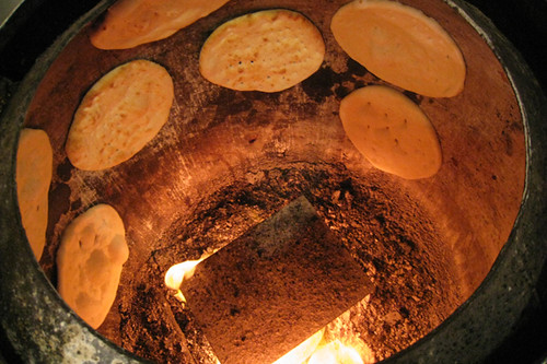A Clay Tandoor Naan Leavened Flatbread Bakes In A