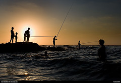 fisherman in tel aviv at sunset | by eraneran70