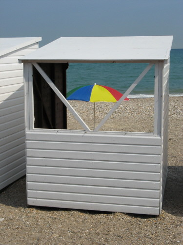 Beach hut and umbrella | by Katie-Rose