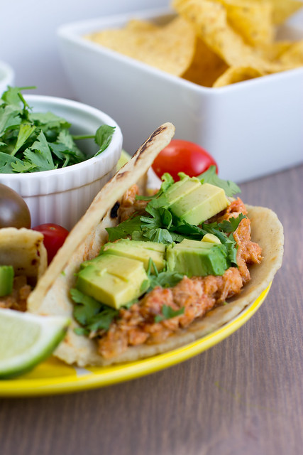Chicken tinga is a hearty, flavorful taco filling packed with tomatoes, tomatillos, and chipotles in adobo sauce.