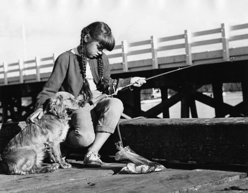 Girl with dog fishing from the dock | by OSU Special Collections & Archives : Commons