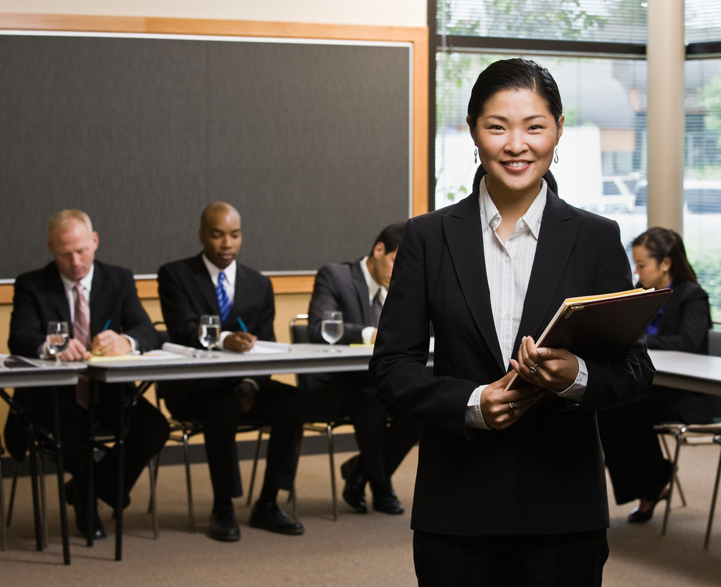 Confident Asian Businesswoman Standing In Front Of Co Work