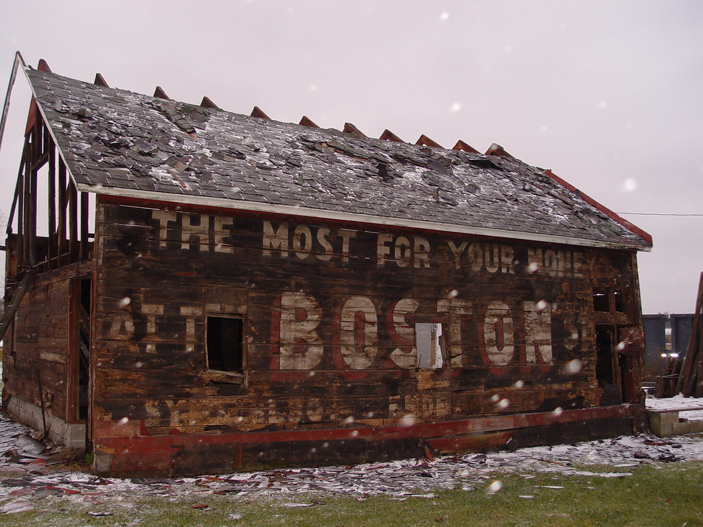 Old Boston Store Ad On Barn Siding Had Covered An Old