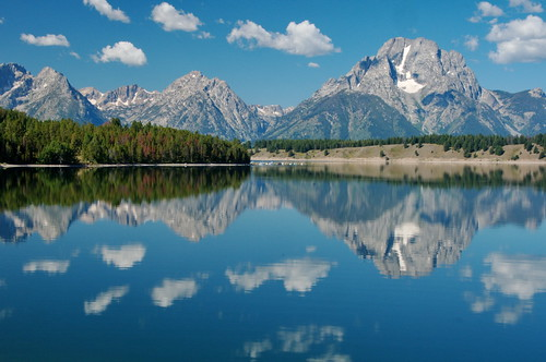Grand Teton across Jackson Lake with Puffy Clouds | by Dave Bezaire