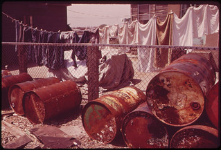 Rusty Oil Cans Pile Up near Home in Broad Channel, a Jamaica Bay Community with Numerous Pollution Problems 05/1973 | by The U.S. National Archives
