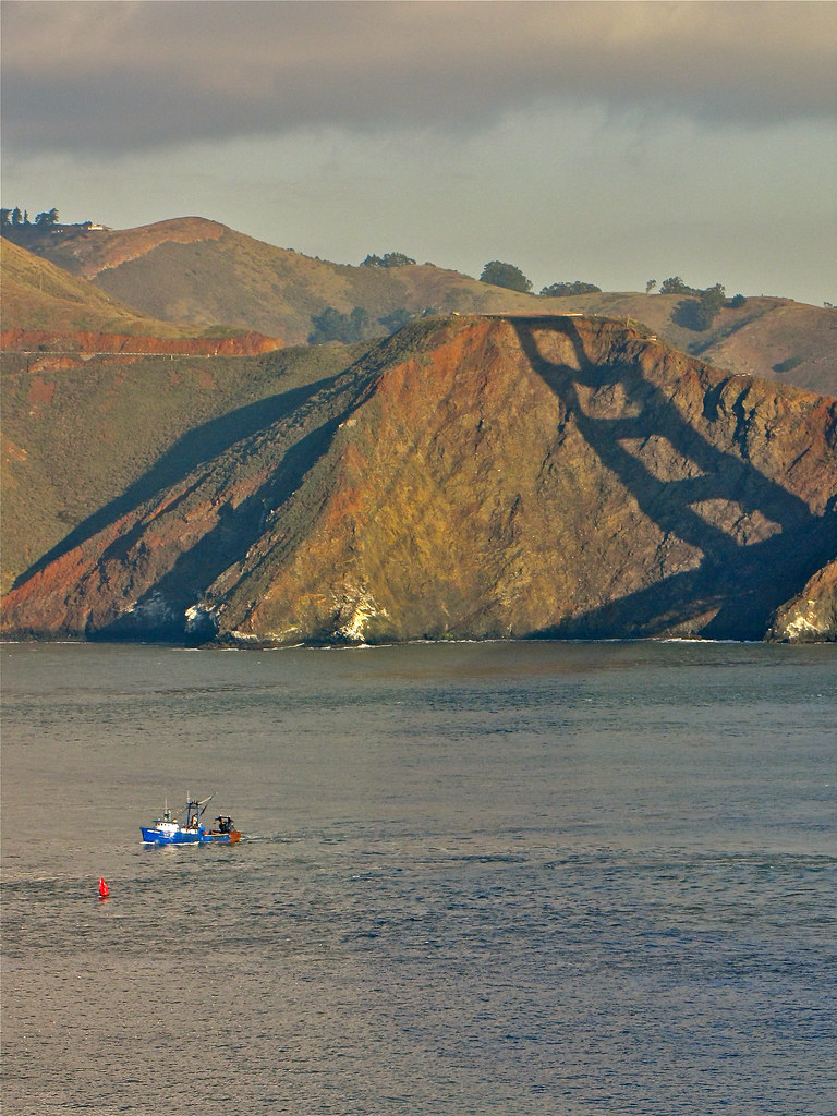 Leaving the shadow of the bridge fishing boat point for Point loma fishing