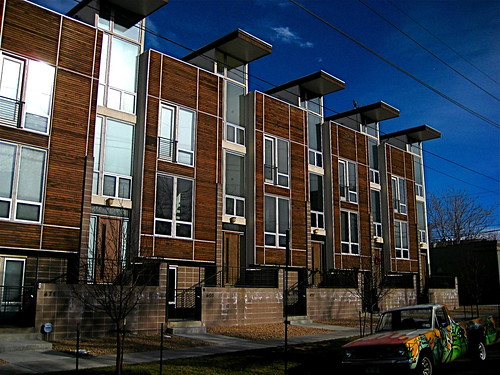 Modern houses by - Dark Wood Facade On Post Modern Three Story Row Houses In