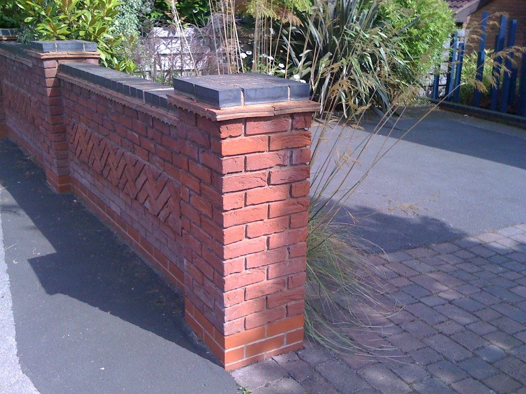 Blue brick top to garden wall more blue brick topped for Brick garden wall designs homes