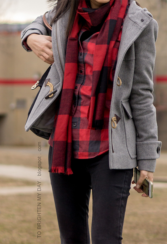 red buffalo check scarf and button up shirt, gray duffle coat with toggles, black skinny jeans