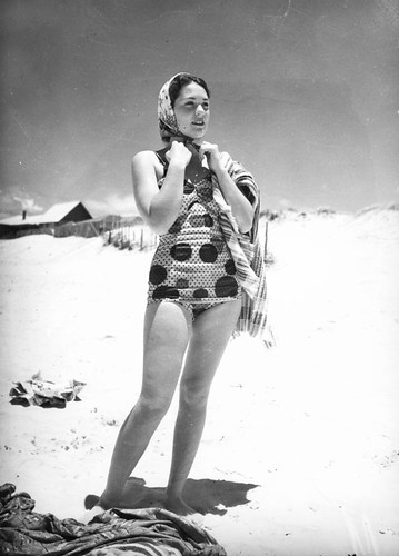 Young woman wearing a swimsuit at Southport, 1940 | by State Library of Queensland, Australia