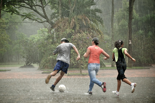 Teenagers playing soccer in the rain | by marlon.net