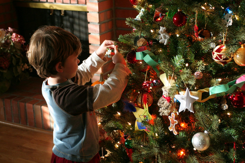 aidan decorates the tree by john morgan