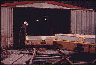 The General Mine Foreman at One of the Tennessee Consolidated Coal Company Mines near Jasper and Chattanooga Stands beside the Shuttle Cars Used to Transport the Miners to Work 08/1974 | by The U.S. National Archives