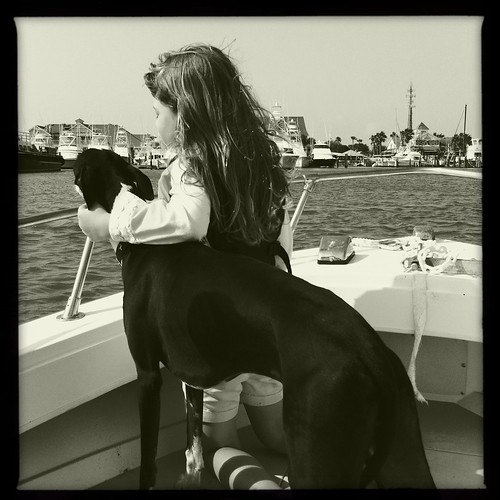 girl with dog on boat | by peterlfrench