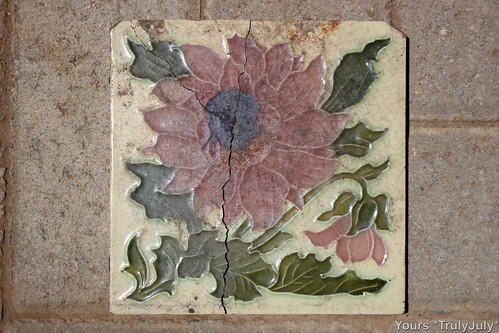 This flower tile is one remembrance of The Broken Palace we excavated from our garden.