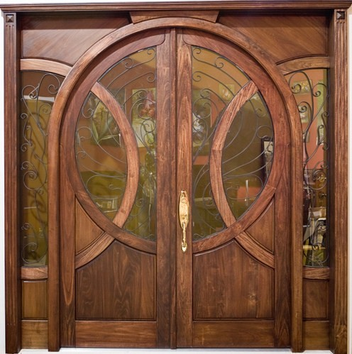Old world solid wood arch entry with raised panel on both for Front door arch design