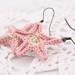 Light pink starfish earrings