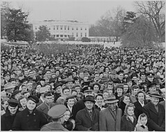Photograph of a large crowd assembled on the South Lawn of the White House for the lighting of the National Community Christmas Tree, 12/24/1945 | by The U.S. National Archives