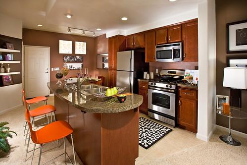 Gourmet island kitchen with granite coutertops hardwood c for Gourmet kitchen island