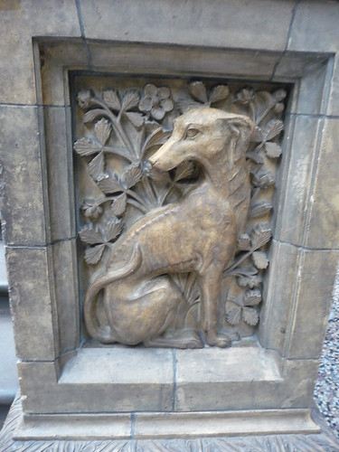 Dog relief carving on the terracotta tile of a