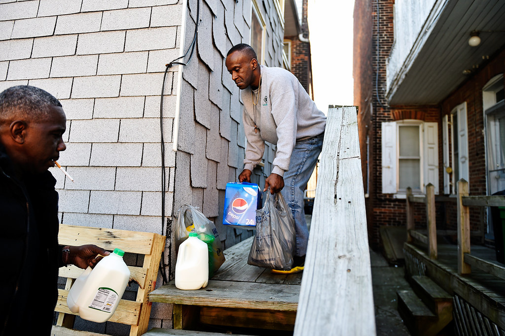 © 2016 by The York Daily Record/Sunday News. Anthony McClair, 50, brings groceries to the back porch for Will Howard, 54, to carry into the Linden Avenue recovery house where they live and which is operated by Sees-the-Day, on Sunday, Feb. 28, 2016.