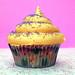 Orange buttercream and purple sanding sugar
